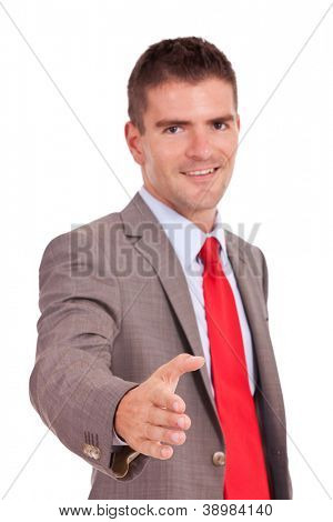 Business man offering a handshake and smiling over white background