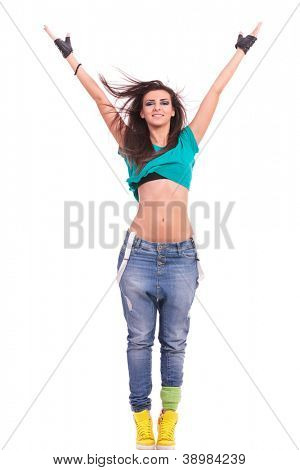 beautiful young woman dancer posing with arms extended above her head, standing on tiptoes, in a Y position, on white background