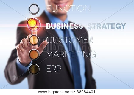 businessman pushing the button for business strategy