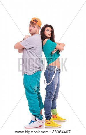 man and woman hip hop dancers standing back to back with arms folded and looking at the camera