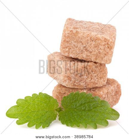 Lump brown cane sugar cubes isolated on white background