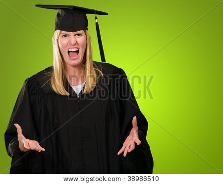 Angry Graduate Woman against a green background