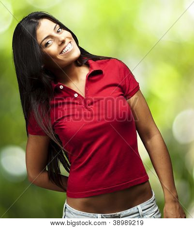 portrait of happy young girl smiling against a nature background