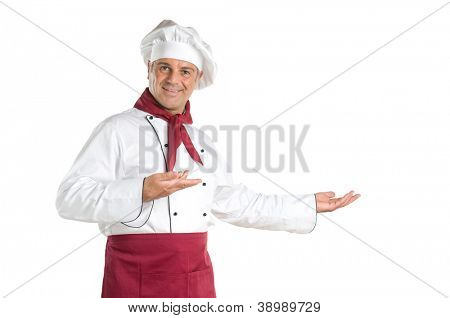 Happy smiling chef presenting your recipes and products isolated on white background