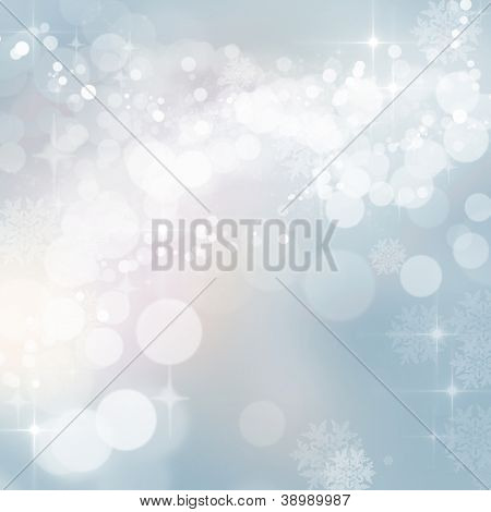 Background of defocused blue twinkling lights with sparkles. Christmas, New Years, winter, party.