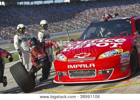 FORT WORTH, TX - NOV 04:  Tony Stewart (14) brings in his car for a pit stop during the AAA Texas 500 at Texas Motor Speedway in Fort Worth, TX on Nov 4, 2012.