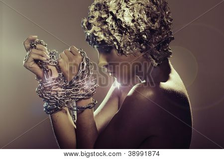 Attractive lady trying to cast off chains