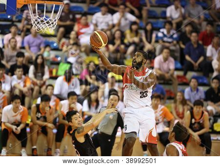 KUALA LUMPUR - OCTOBER 28: Dragons' Moala Tautaa #33 scores an easy basket against the Firehorse team in a Malaysia National Basketball League match on October 28, 2012 in Kuala Lumpur, Malaysia.