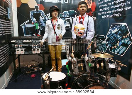 SUBANG JAYA - NOV 10: Unidentified students from Thailand show their music robots at the World Robot Olympaid on November 10, 2012 in Subang Jaya, Malaysia. The theme is connecting people with robots.