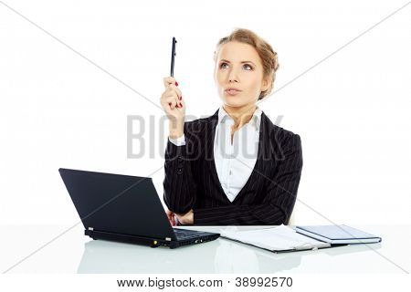 Portrait of a businesswoman working on a laptop and seriously thinking about something. Isolated over white.