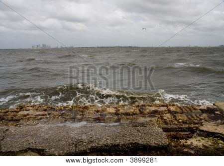 Gloomy Afternoon Surf On Eroding Seawall
