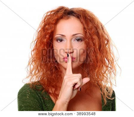 Closeup of redhead woman quiet gesture on a white background