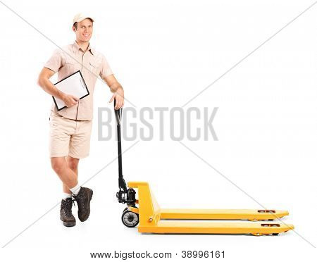 Full length portrait of a manual worker holding a clipboard and fork pallet truck isolated on white background