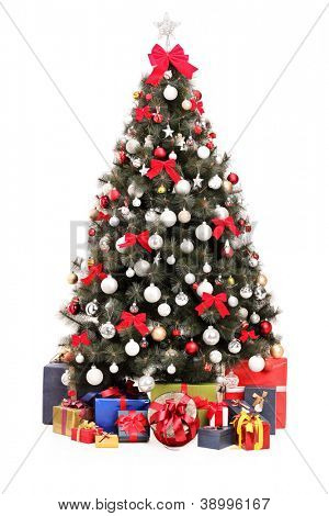 A studio shot of a decorated Christmas tree and gift boxes isolated on white background