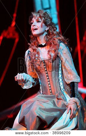 """MOSCOW - FEBRUARY 3: Actress Anastasia Makeeva sings in musical """"Francois Villon. Three days in Paris"""" at Palace on Yauza on February 3, 2012 in Moscow, Russia."""