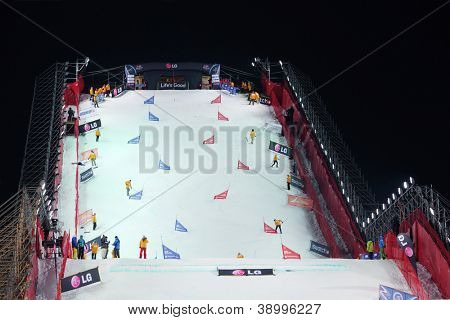 MOSCOW - MARCH 3: Stewards clean ramp at Snowboard World Cup in Luzhniki sports complex on March 3, 2012 in Moscow, Russia.