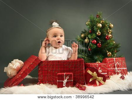 cute little girl with presents