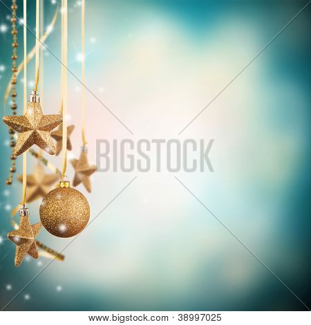Christmas theme with golden glass stars and free space for text