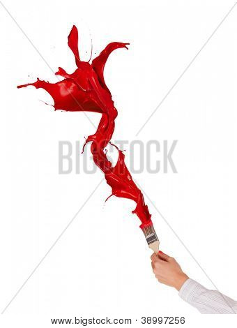 Red paints splashing out of brush. Isolated on white background