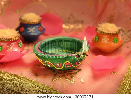An Indian lamp and tiny earthen pots