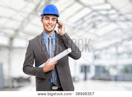Portrait of a smiling engineer talking on the phone