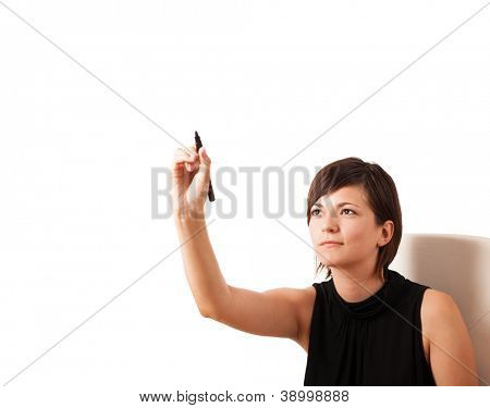 Young woman drawing on wihteboard with white copyspace isolated on white