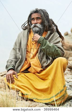 Indian old monk sadhu in saffron color clothing