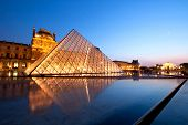 PARIS-APRIL 16: Reflection of Louvre pyramid shines at dusk during the Summer Exhibition April 16, 2
