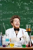 stock photo of mad scientist  - Scientist laughs madly in his laboratory - JPG