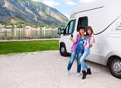 foto of motorhome  - Happy young womans outside motorhome - JPG