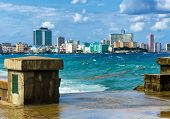 foto of malecon  - The skyline of Havana with a turbulent sea and El Malecon in the foreground - JPG