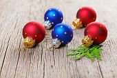 pic of shaky  - Christmas balls on wooden background with green thuja branch - JPG