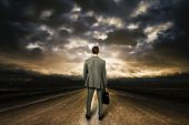 image of lonely  - Business man standing in the middle of the road - JPG