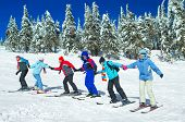 image of upstairs  - Group of skiers come upstairs snowy mountains  - JPG