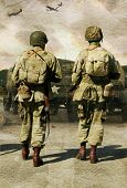 pic of army soldier  - digital coposite of two american second world war soldiers walking towards their jeeps whilst two mustangs fly over head - JPG