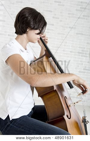 Girl is playing cello