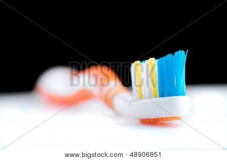 Colorful toothbrush on black and white background