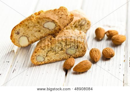 cantuccini cookies and almonds on wooden table