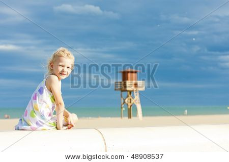 little girl on the beach in Narbonne Plage, Languedoc-Roussillon, France