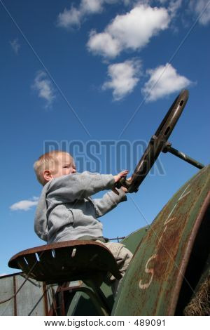 Little Boy On Antique Tractor