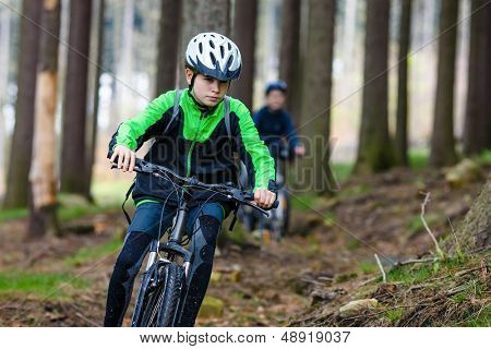 Young people riding bikes