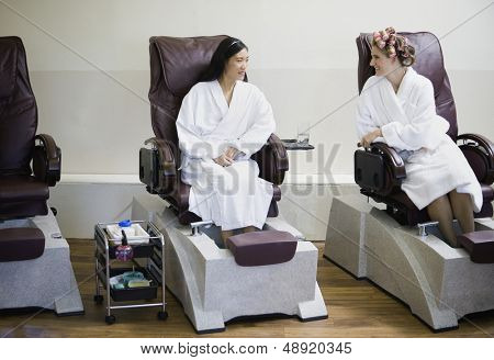 Two women receiving pedicure