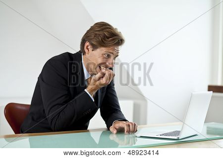 Anxious Businessman Looking At Laptop