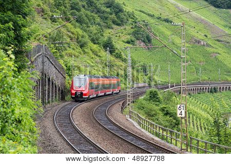 Train Driving Along Vineyards Near The River Moselle In Germany