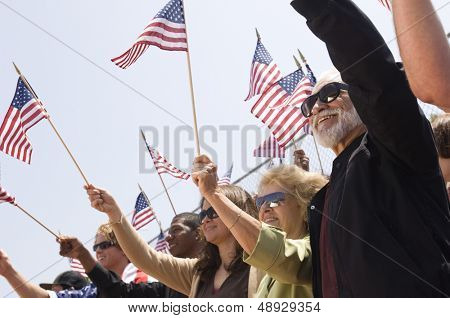 Multiethnic group of people with American flag during a rally