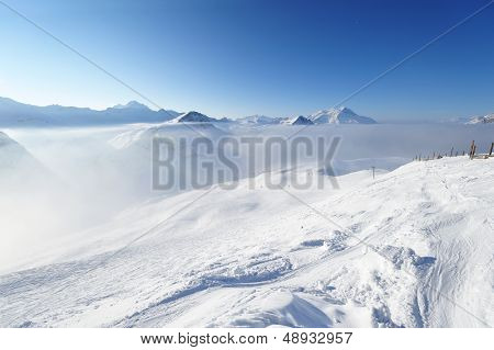 Mountains in clouds with snow in winter, Val-d'Isere, Alps, France