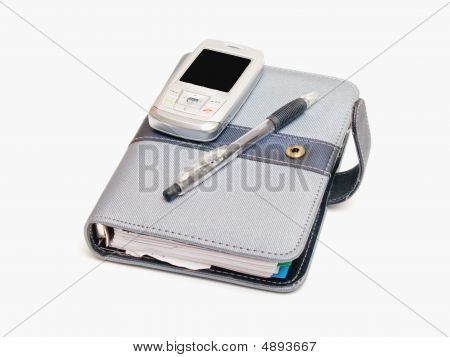 Business Tools - Pen Diary And A Cell Phone
