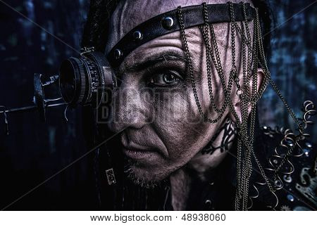 Portrait of a steampunk man over grunge background.