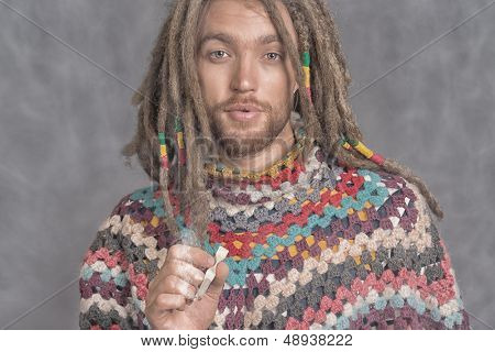Portrait of a rastafarian young man.