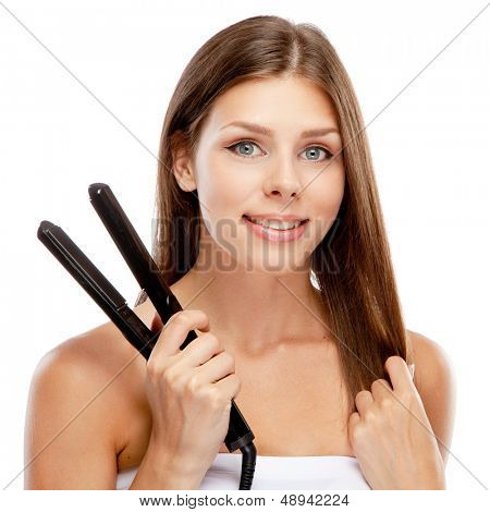 Young woman with a hair straightener, white background